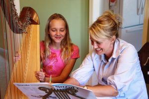 Laura Erickson teaching harp lessons in West Des Moines, Iowa